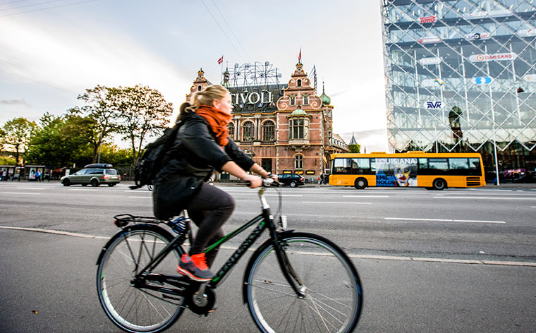 Woman biking Denmark
